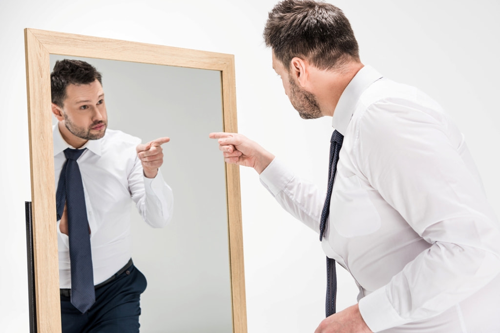 A man and his reflection in the mirror