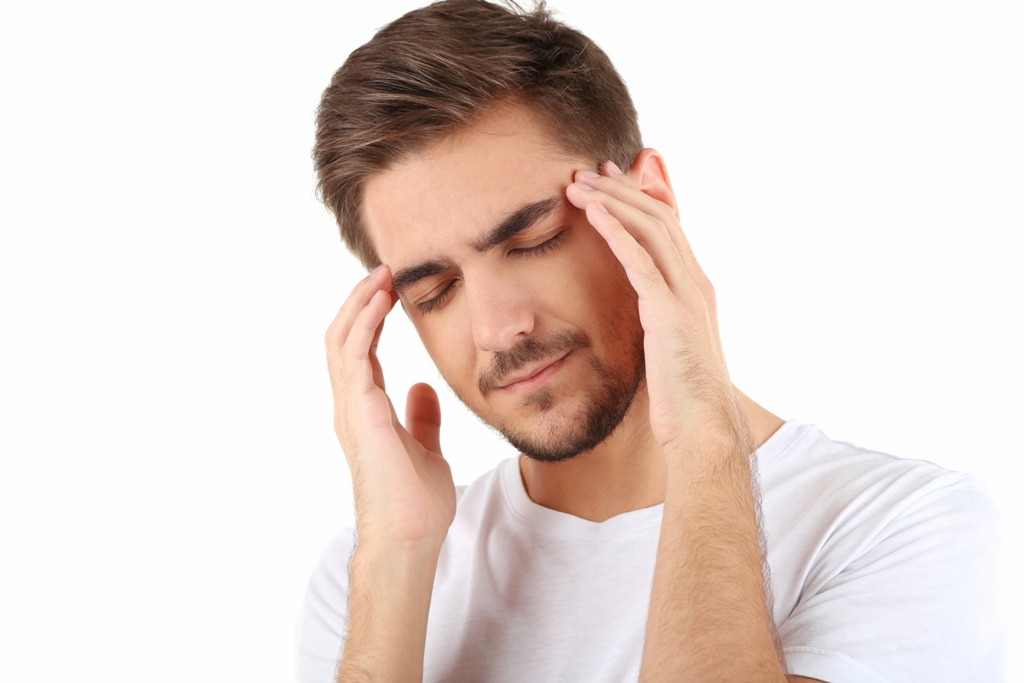 a young man with headache