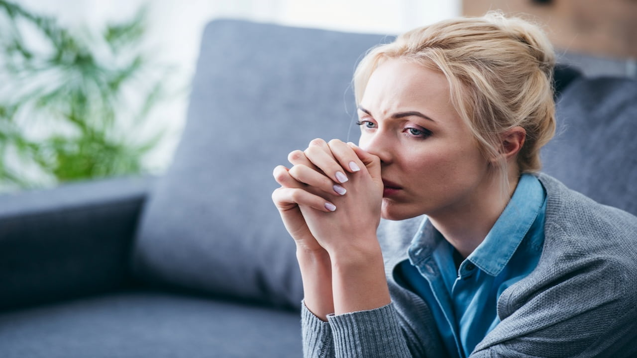 a sad blonde woman portrait