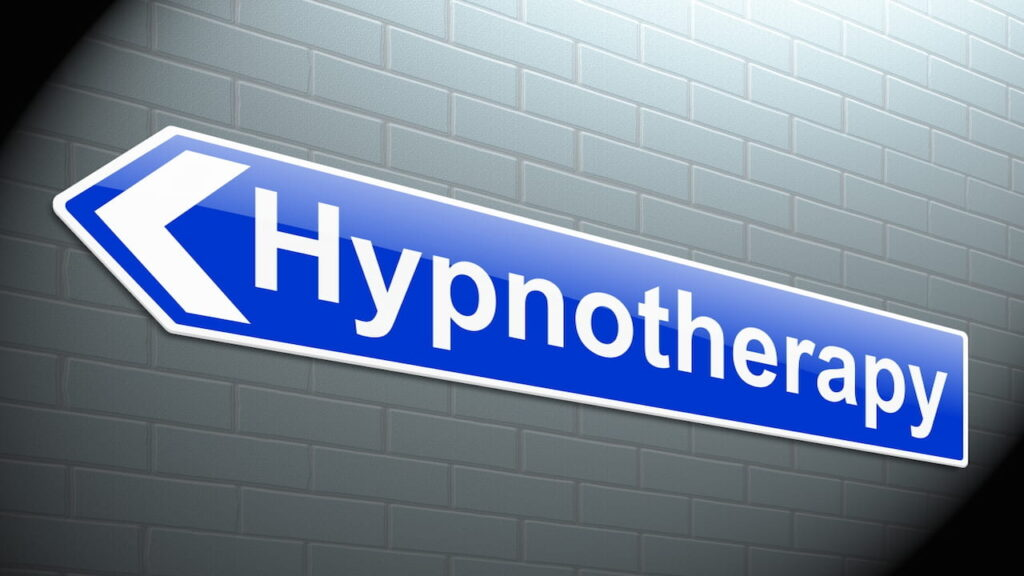 A sign showing the way to the hypnotherapy