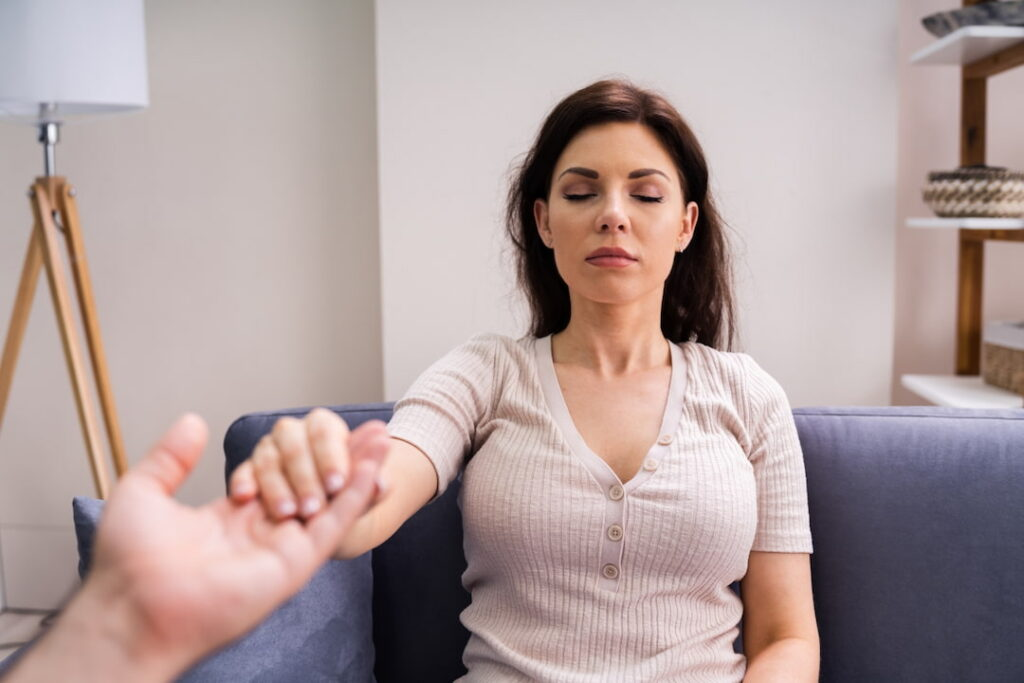 A woman at the hypnotherapy treatment