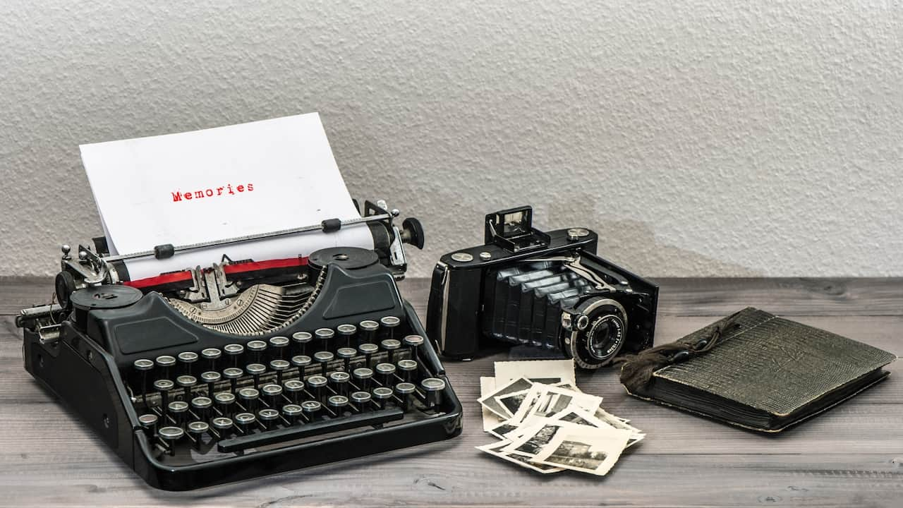 old photos, a typewriter and a camera