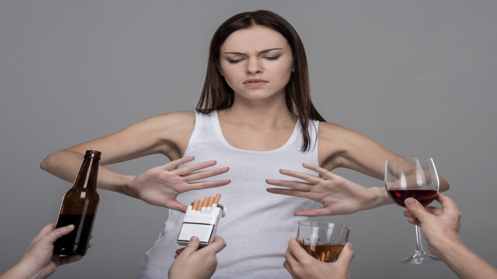 a girl saying no to offered drinks and cigarettes