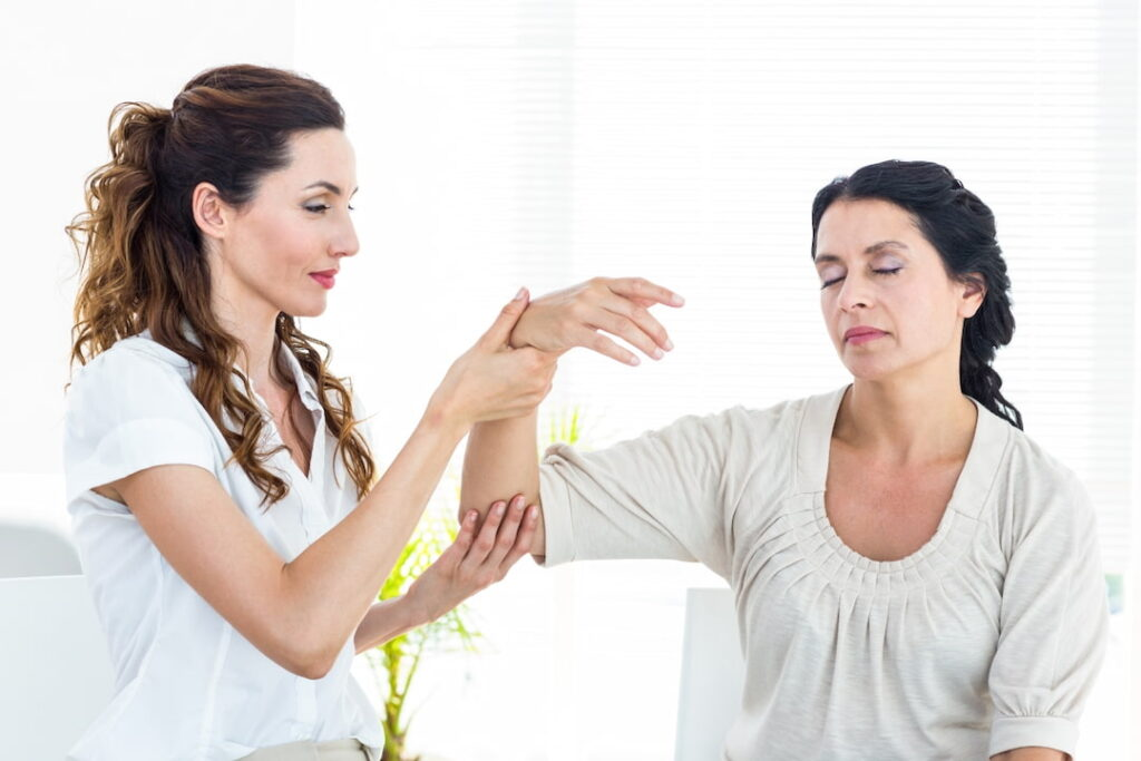 A therapist hypnotizing the patient