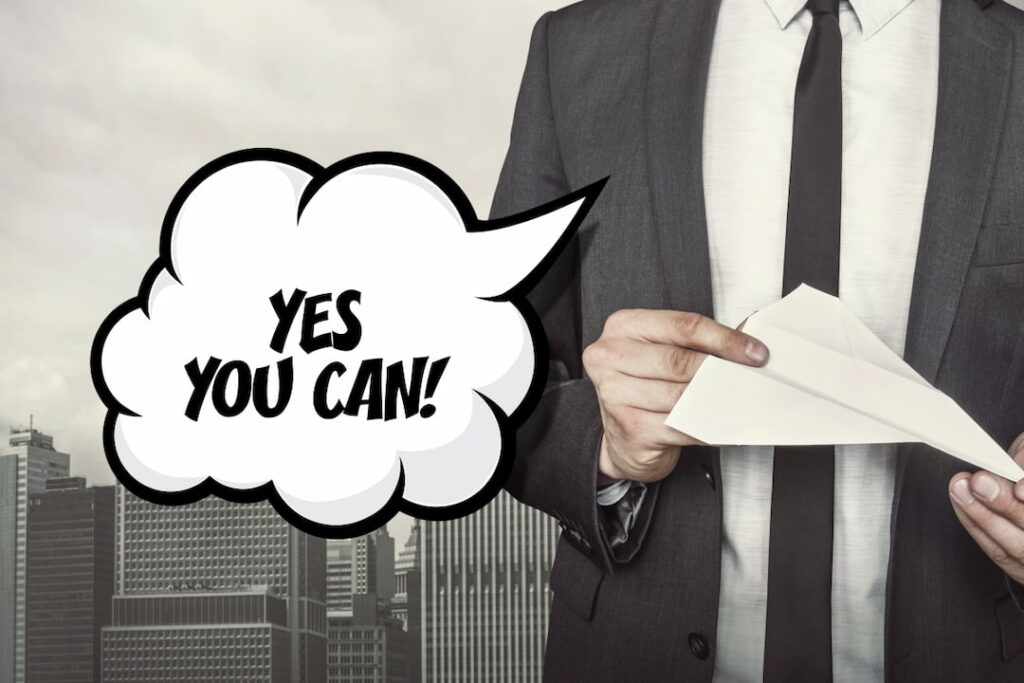 a person in a suit telling YES YOU CAN