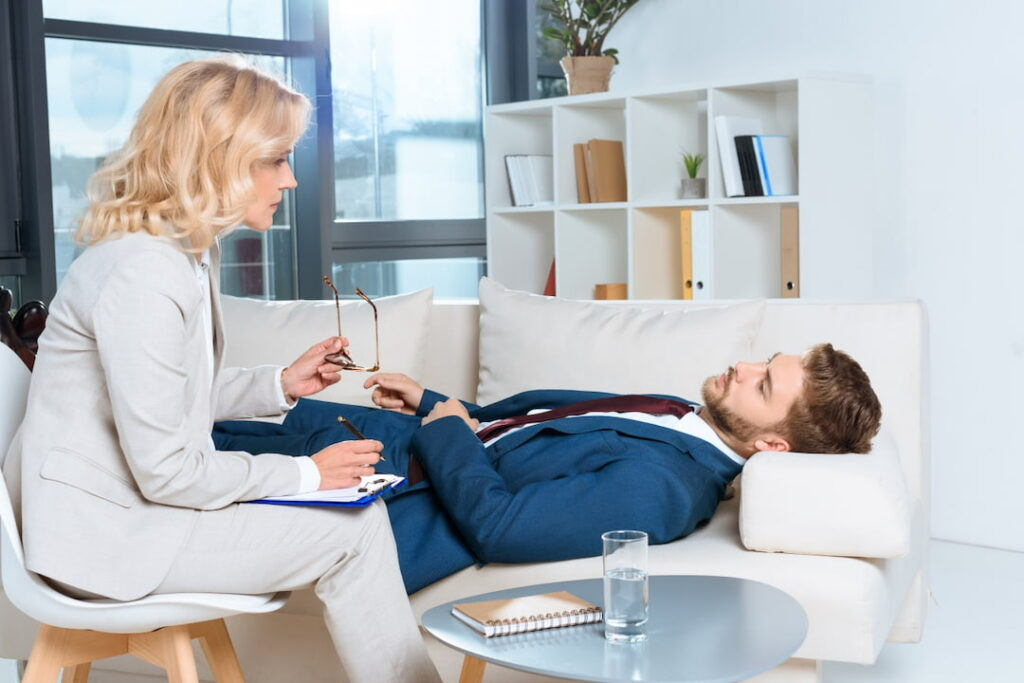a young man lying on the couch on the therapy session