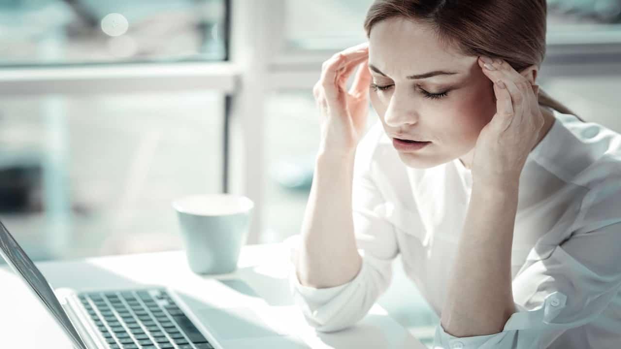a woman with headache