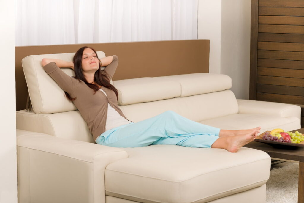 a young woman relaxing on the sofa