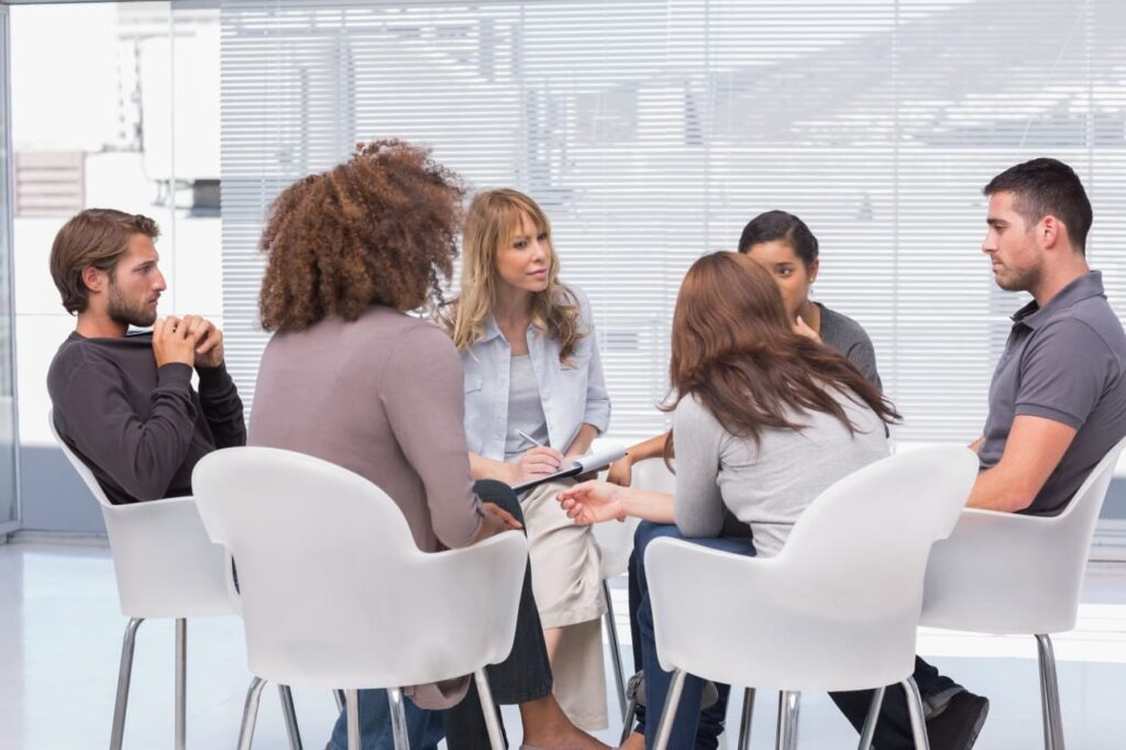 A group of people on a therapy session