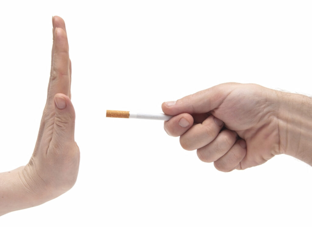 Hand saying no thanks to proposed cigarette