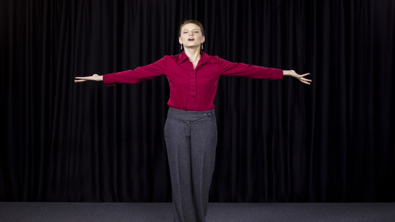 woman spreading her arms on the stage