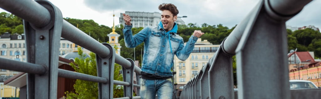 a happy young man on the bridge