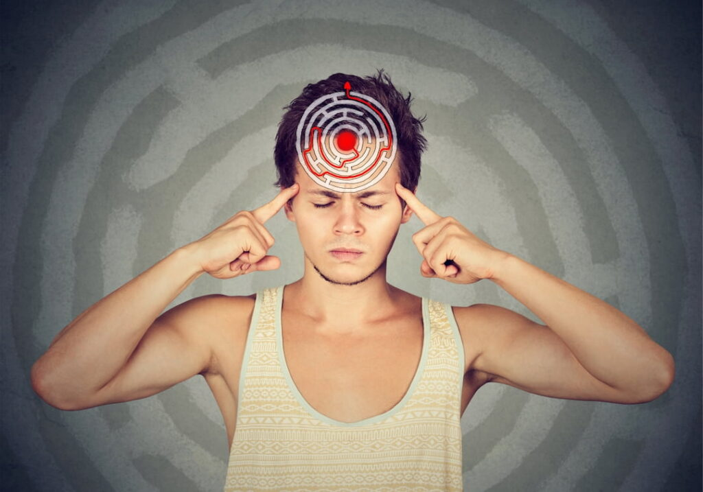 young man with closed eyes and labyrinth illustration on his forehead