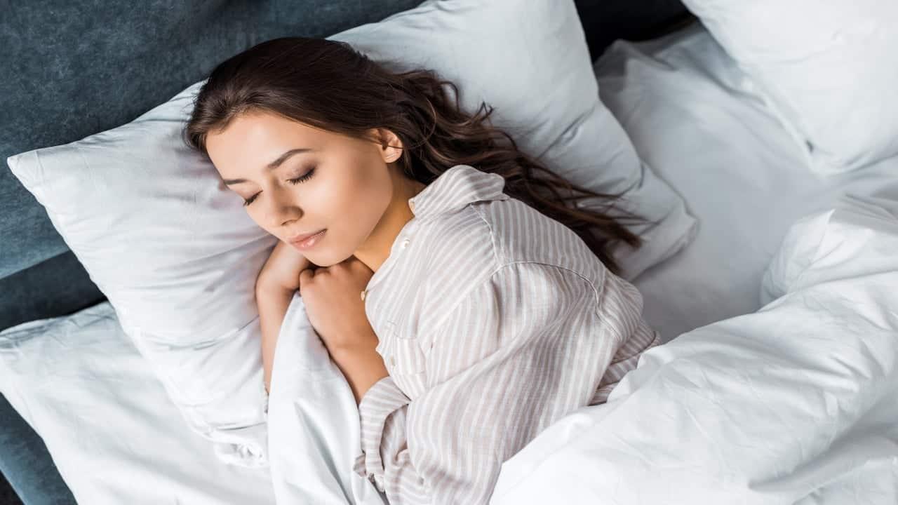 Beautiful brunette woman in pajamas sleeping