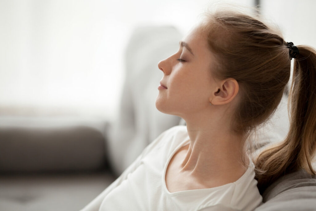 a young girl taking a deep breath