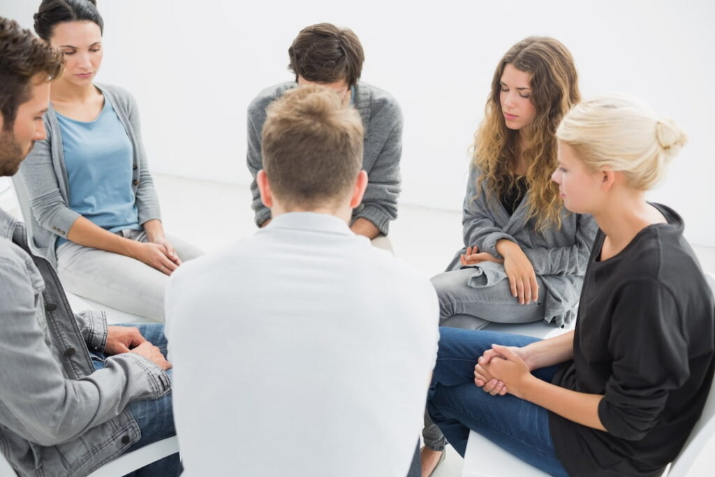 a group of people sitting in the circle