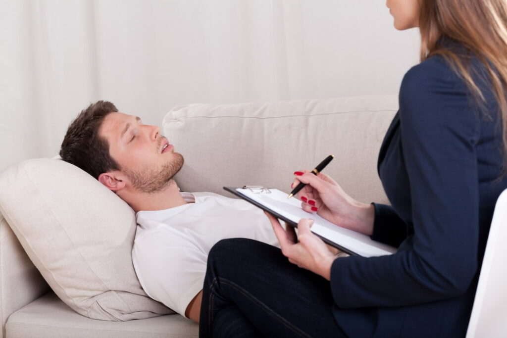 A patient in hypnotized state at the session with his therapist
