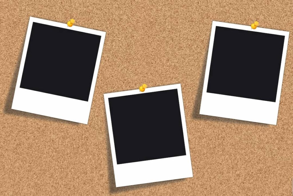 empty black photos pinned to the board