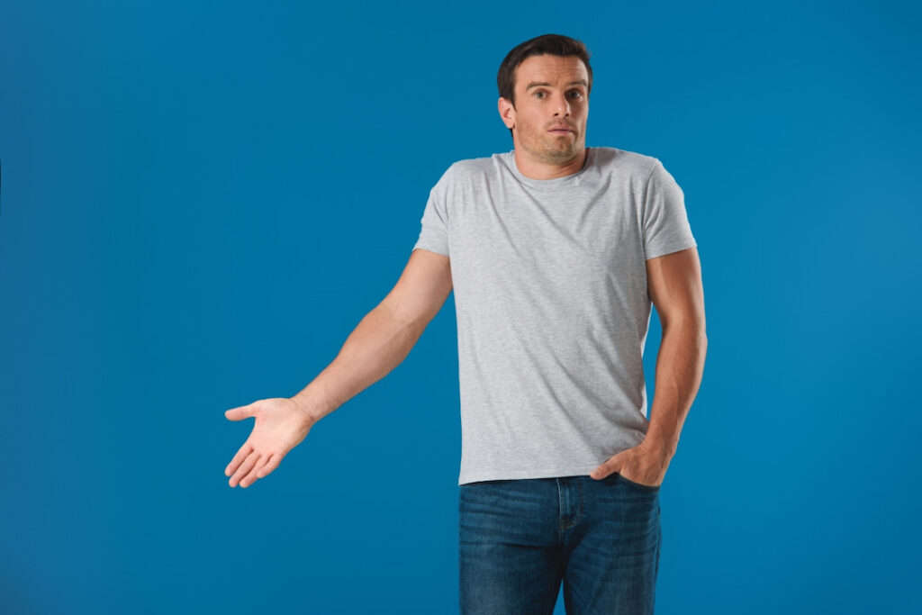 a man gesturing with his hand