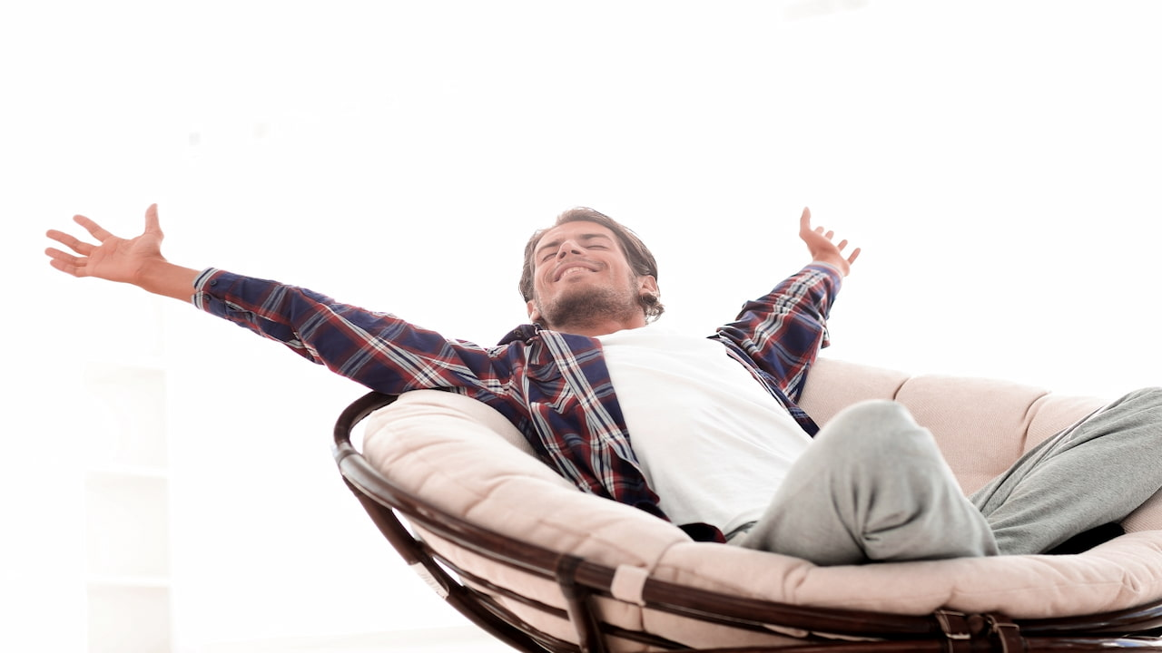 a man in the chair feeling free after quitting smoking