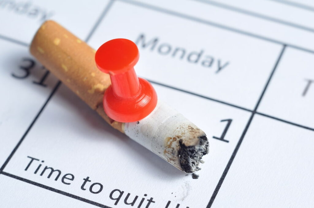 a cigarette pinned to the calendar