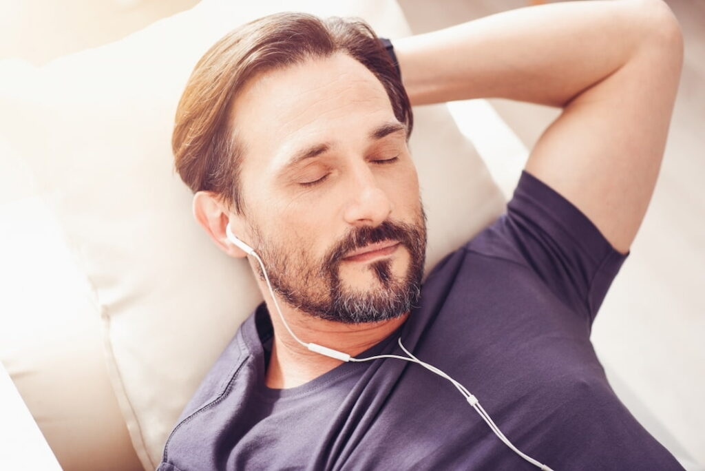 a man listening to hypnosis audio