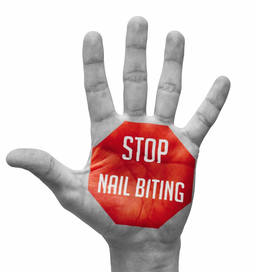 Stop Nail Biting sign written on the palm