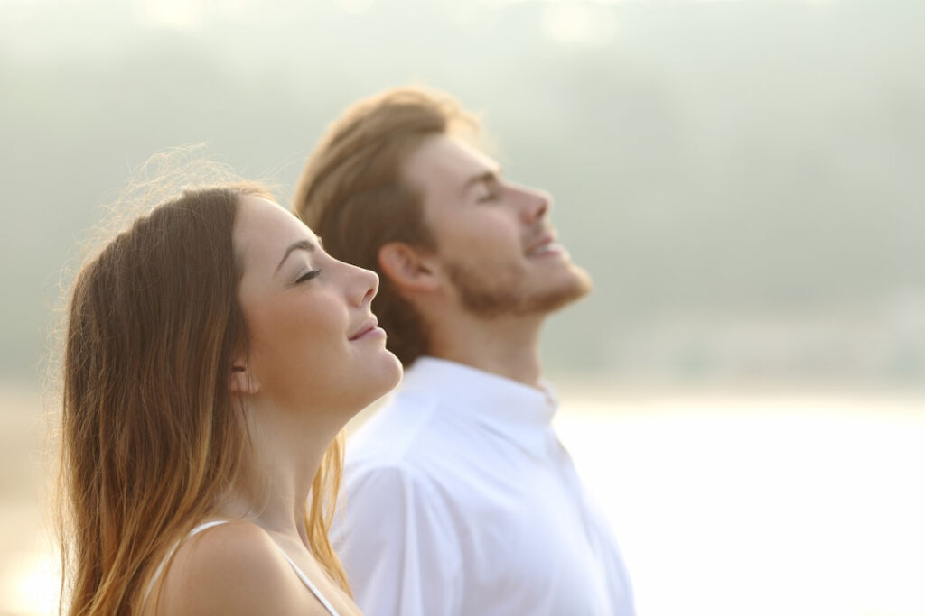 a man and a woman relaxing outside