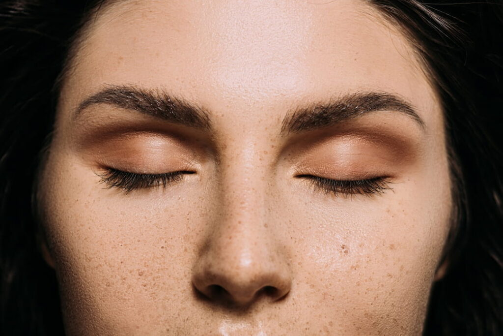 closeup of a woman with closed eyes