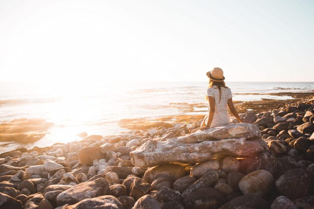 a girl watching a sunset