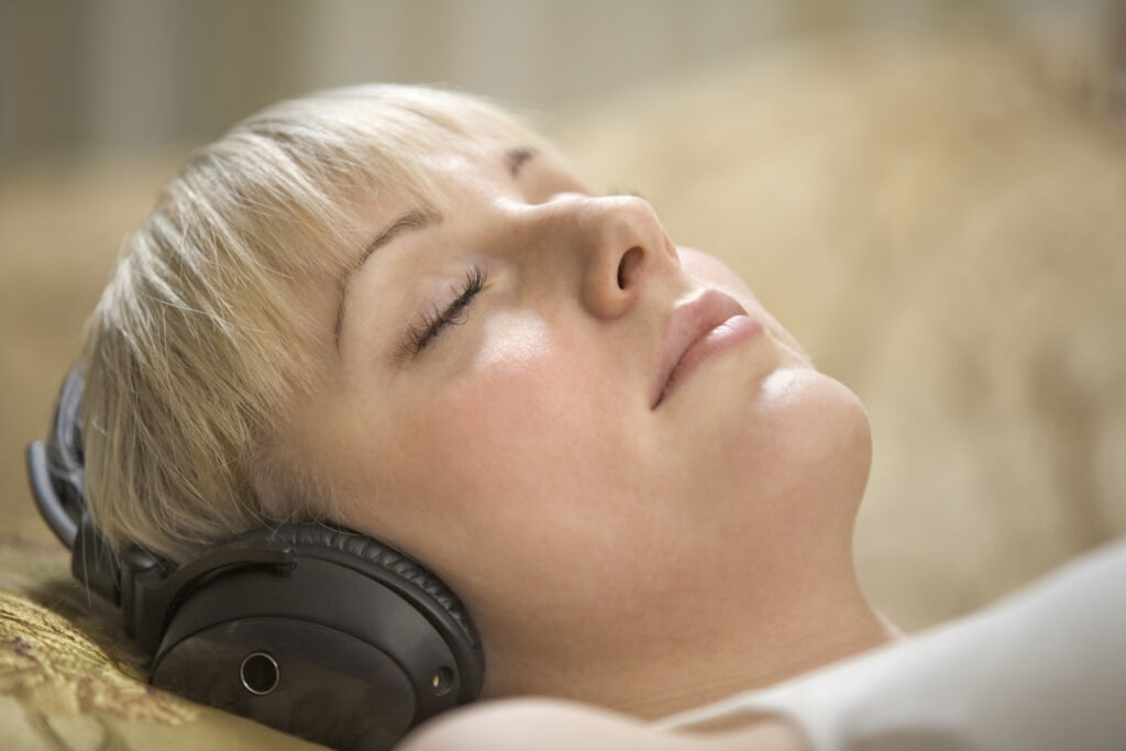 a woman listening to hypnosis session