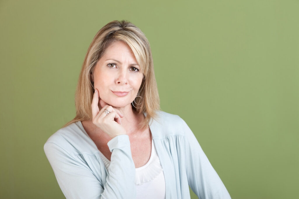 mature blonde woman with skeptical face