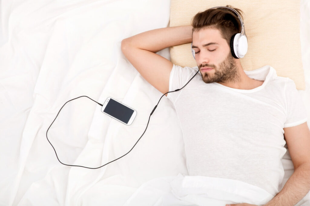 a man listening to audios from his cellphone