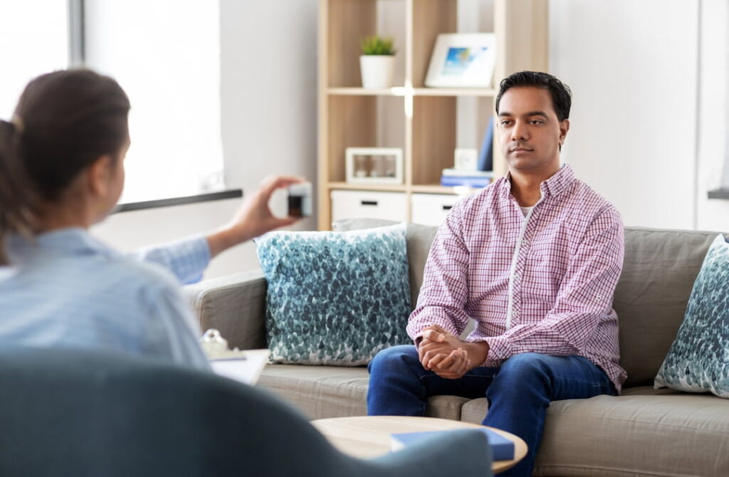a man at the session with his therapist