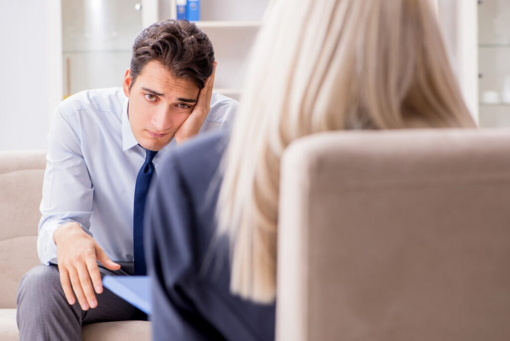 a man looking for help at the therapist
