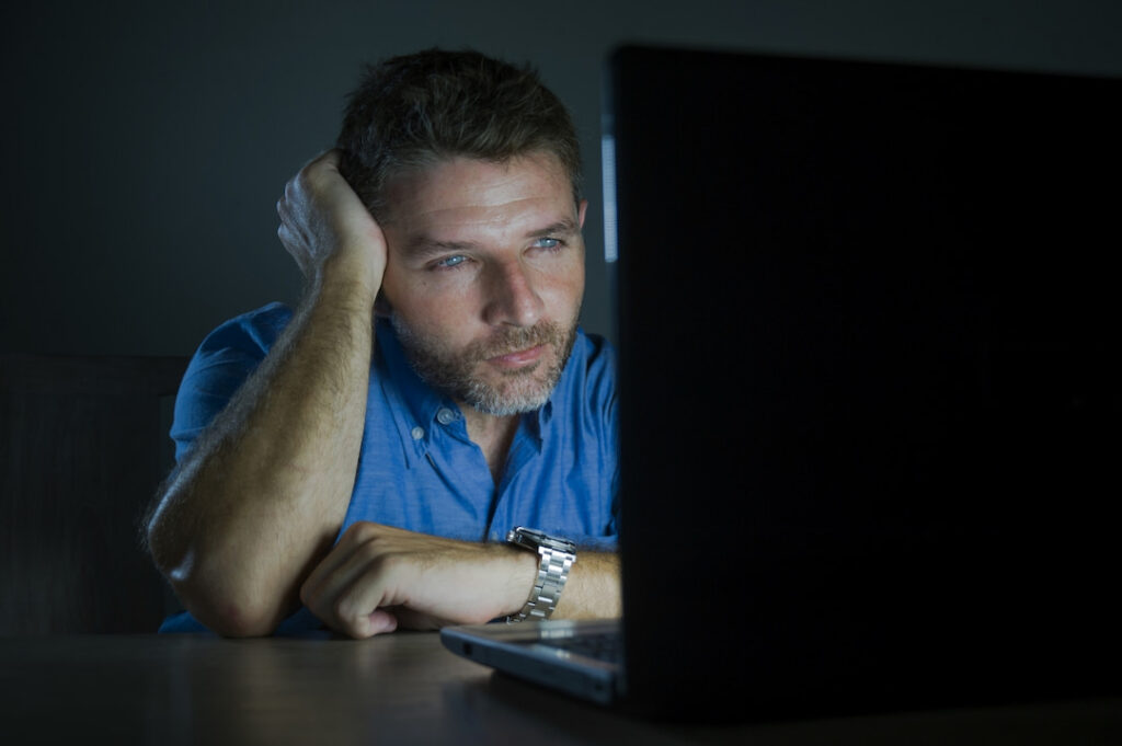 a man watching porn on his laptop