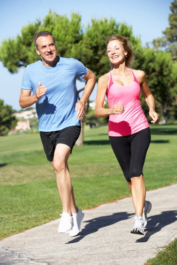 a man and a woman jogging outdoor
