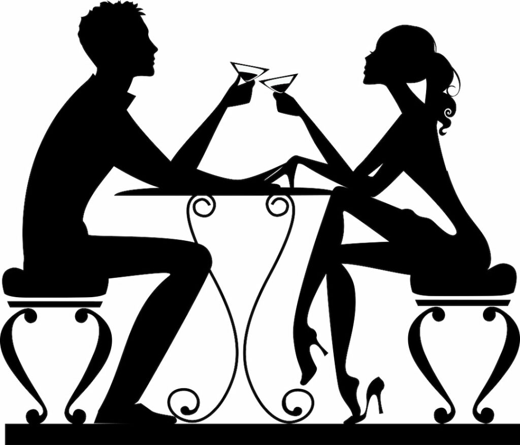 silhouette of a man and a woman at a table with glasses in hands