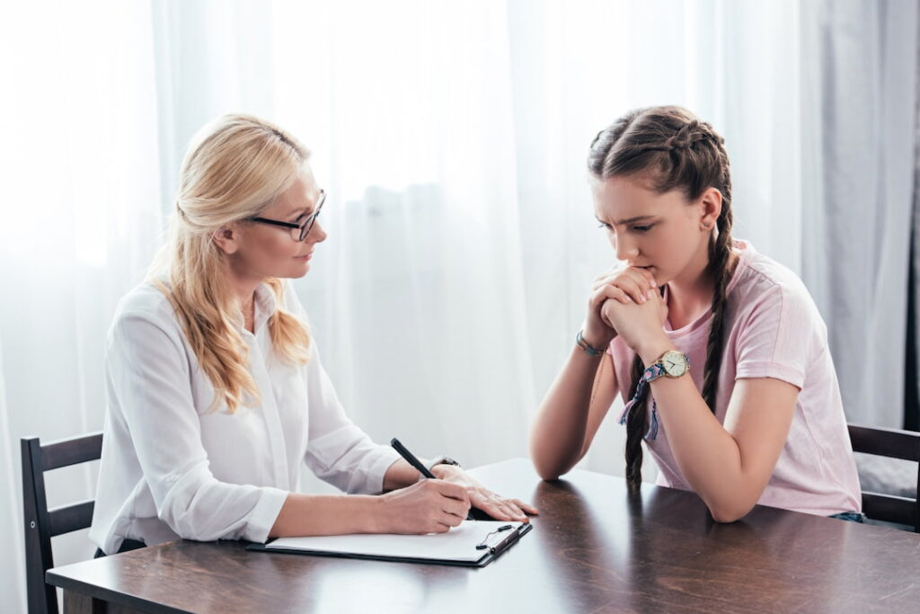 a young girl at the session with her therapist