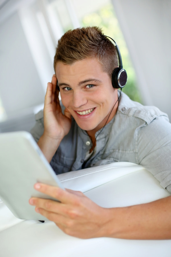 a young man listening self-hypnosis audio