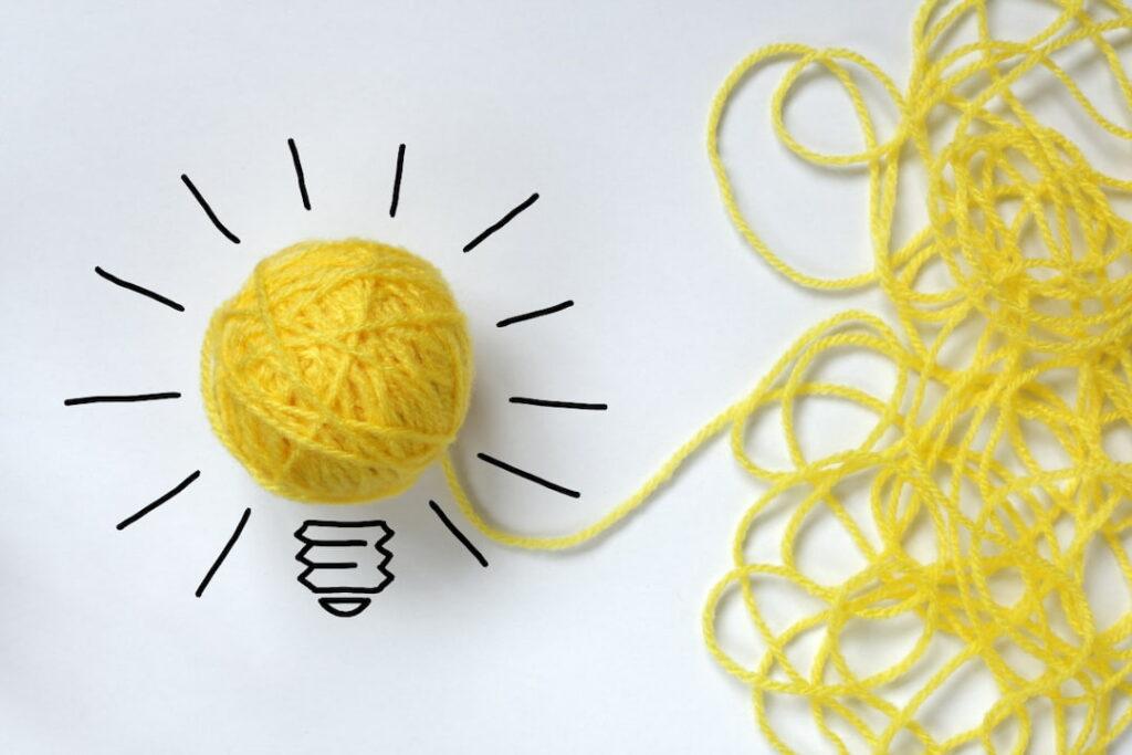 good idea concept made of yellow yarn