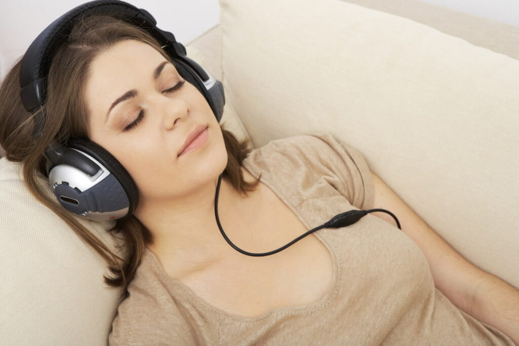 a woman with closed eyes and headphones