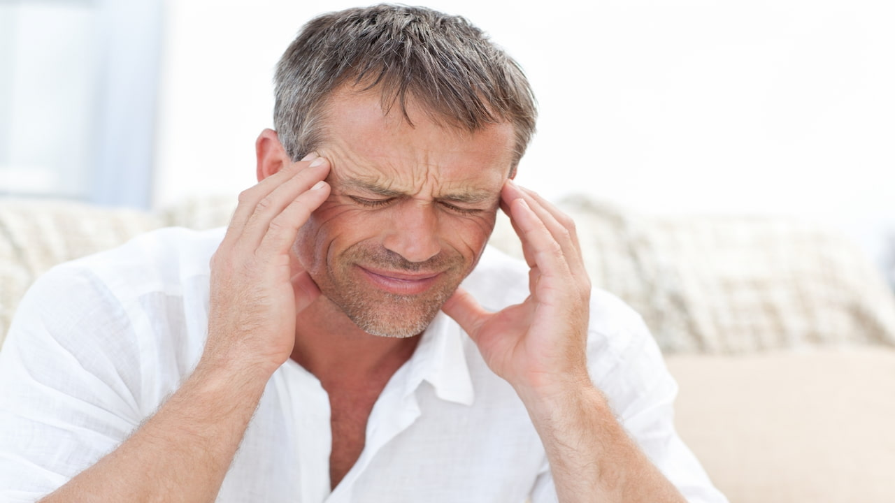 a man suffering from migraine