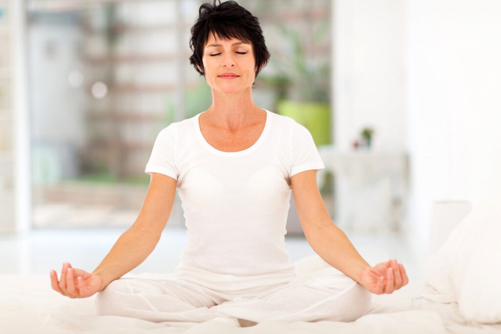 a woman in white meditating