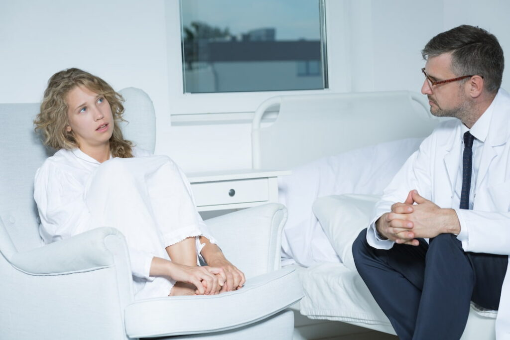 a young woman talking to her therapist