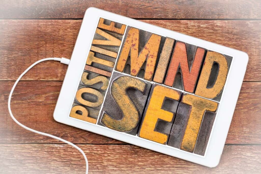positive mindset concept with words framed in tablet display