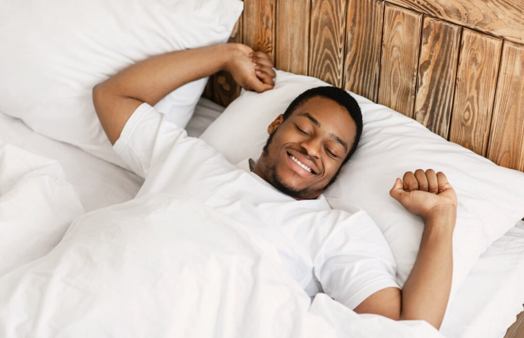 a man sleeping in the bed