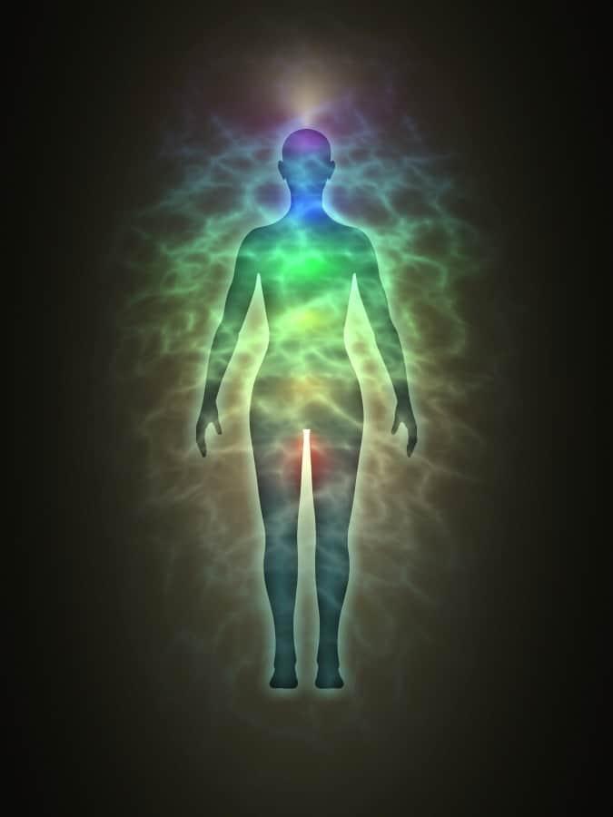 a colorful lights around human body illustration
