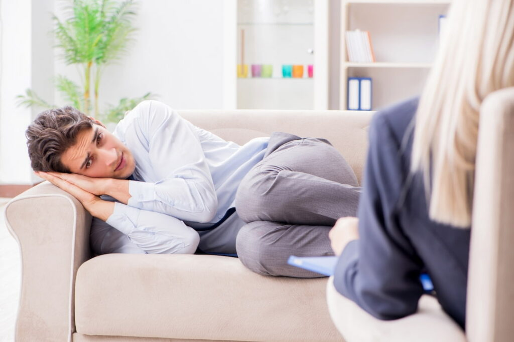 a man lying on the couch during the hypnosis therapy session