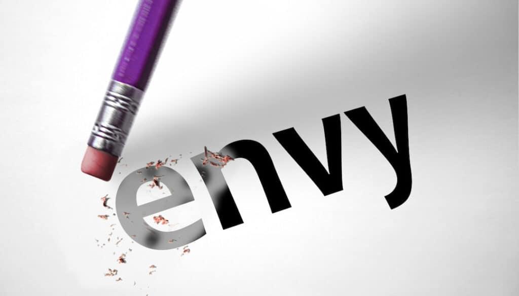 erasing the word ENVY